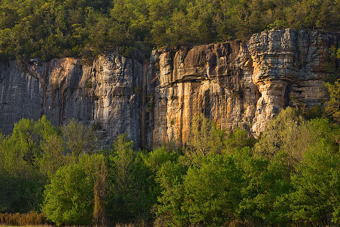 The late evening sun illuminates Roark Bluff, at Steele Creek on the Buffalo National River