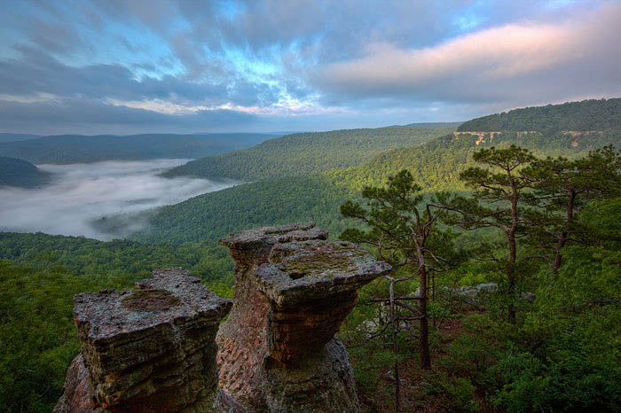 Sunrise at the Tea Table Rocks on Home Valley Bluff. The fog rising is from the Big Piney River below.