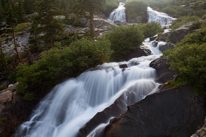 The last light after the clearing storm illuminates Sapphire Falls in McCullough Gulch near Breckenridge, Colorado