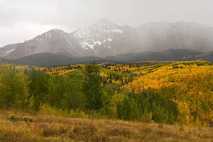 An approaching storm covers Mount Wilson near Telluride, Colorado