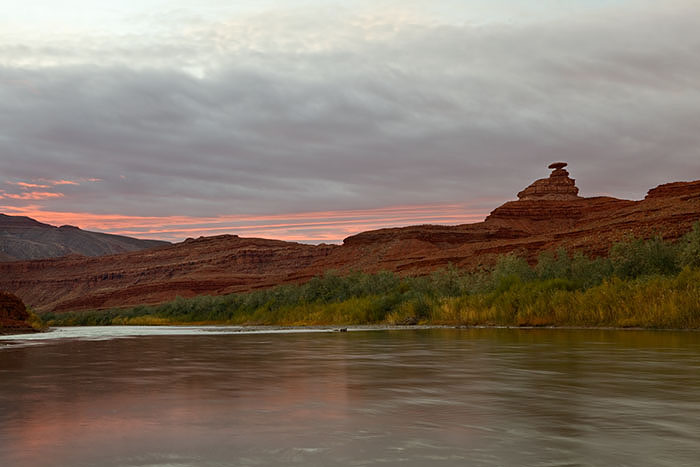The famous Mexican Hat rock formation looms over our camp at sunrise.